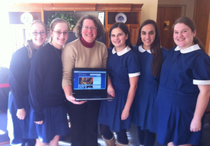 Gateway moderator, Mrs. Lorenz, in middle with computer